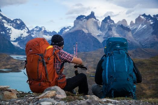 Two men hike in Parque Torres Del Paine, Patagonia with the Mountainsmith Apex 60. Apex 80 and Pyrite trekking poles