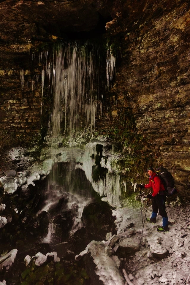 Dan Nash of Satori Adventures approaches a frozen waterfall with his Mountainsmith Mystic backpack