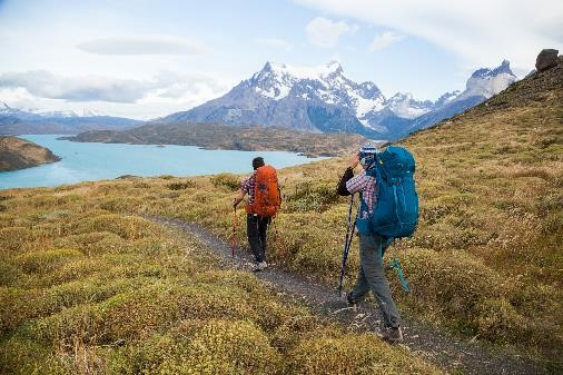 Two men hiking in Parque Torres Del Paine, Patagonia with the Mountainsmith Apex 60, Apex 80, Rhyolite and Pyrite trekking poles
