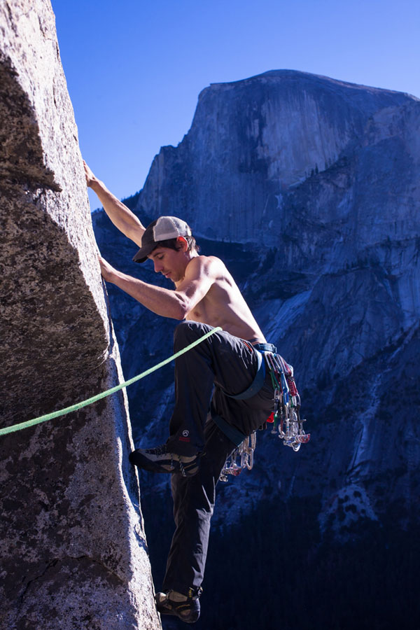 Young man rock climbs in Verdone Gorge, France