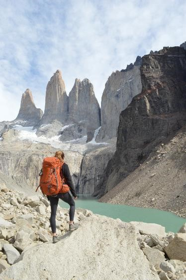 Woman hiking in Parque Torres Del Paine, Patagonia with the Mountainsmith Apex 60 WSD