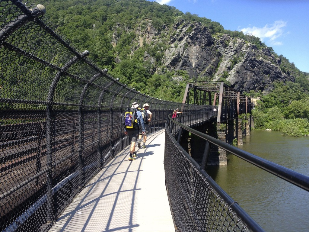 Hikers leaving Harper's Ferry, West Virginia and crossing the Potomac River bridge into Maryland.