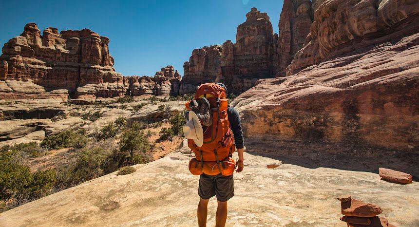 Man carries Mountainsmith backpack in Canyonlands Naitonal Park, Utah