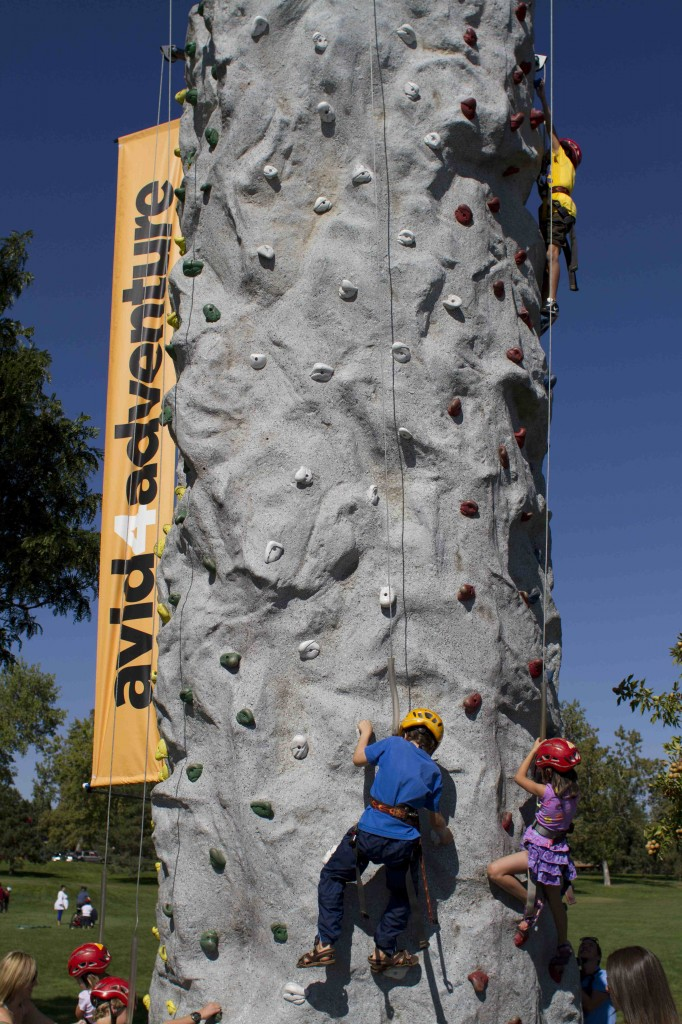 Kids testing out the climbing wall at Backpacker Magazine's Adventures Denver