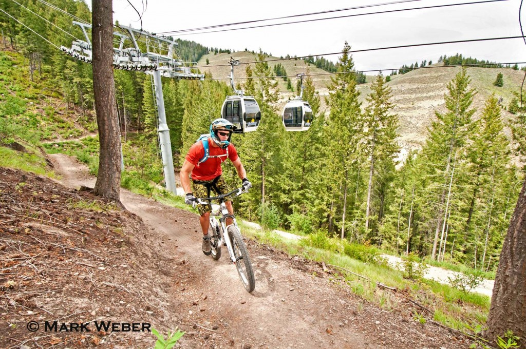 Elijah Weber mountain biking the River Run Trail on Bald Mountain under the Roundhouse Gondola at Sun Valley Resort near the city of Ketchum in central Idaho