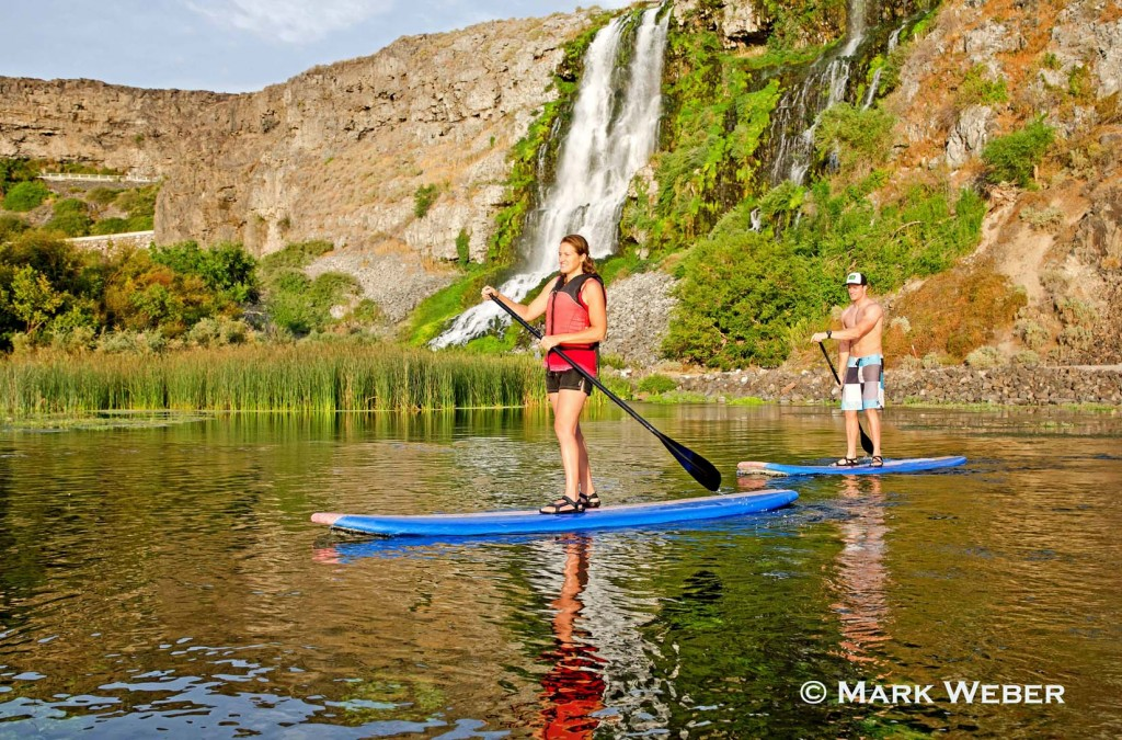 Jessica Florian and Elijah Weber riding the Standup Paddle Board at Thousand Springs in the Snake River Canyon near the city of Hagerman in southern Idaho, Mark Weber Photo