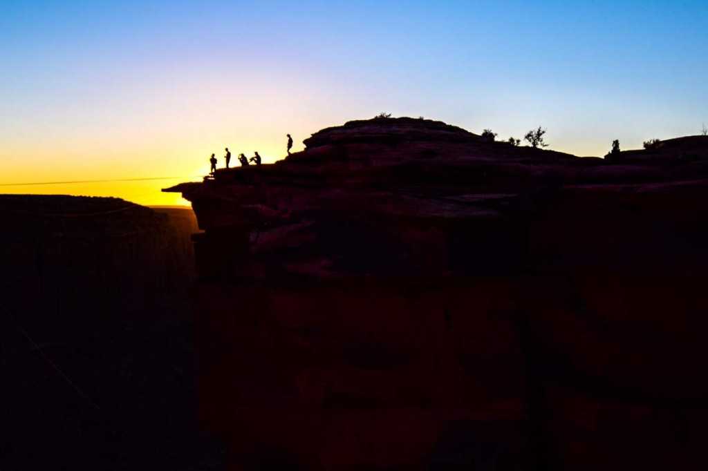 minons on the edge of the canyon in moab at the fruit bowl at sundown