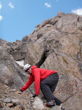 Our friend Darrin from Smartwool making a few precarious moves to exit the top of the couloir onto the summit ridge of Mount Evans.