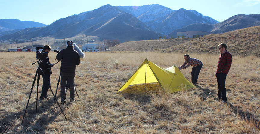 The crews from Mountainsmith and Three Strings Productions ready the set of for the Mountain Shelter LT