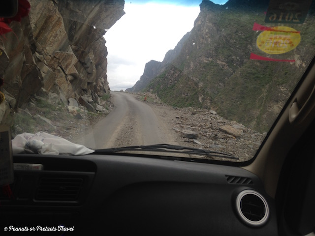 Car on road into Tiger Leaping Gorge, China
