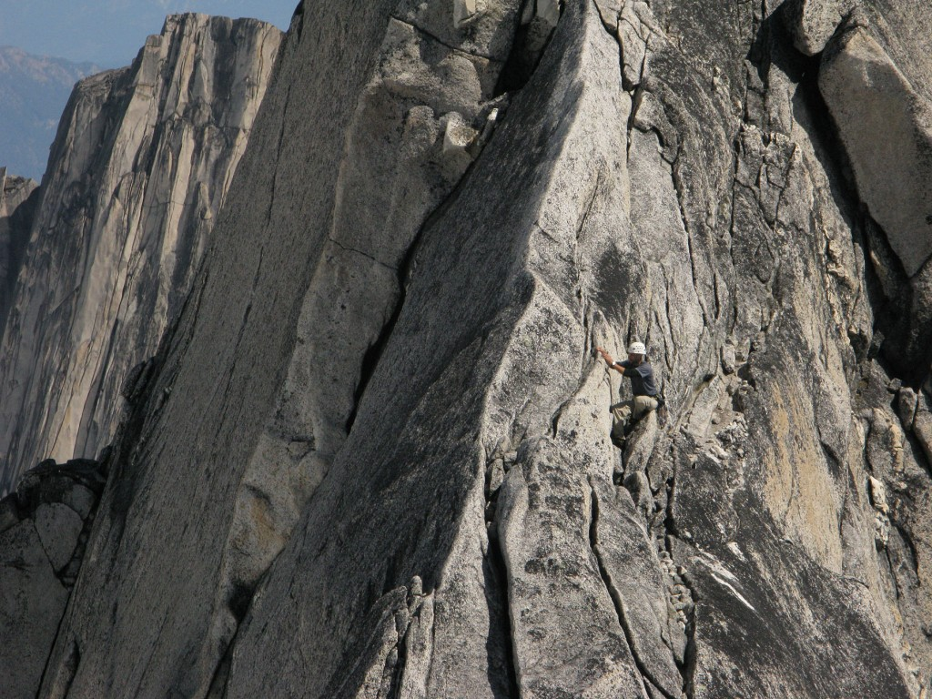 A climber  on a rock face in the Bugaboos of British columbia