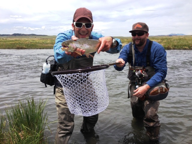 Jay Getzel, Mountainsmith President holds up a cutbow trout on the South Platte River in Colorado