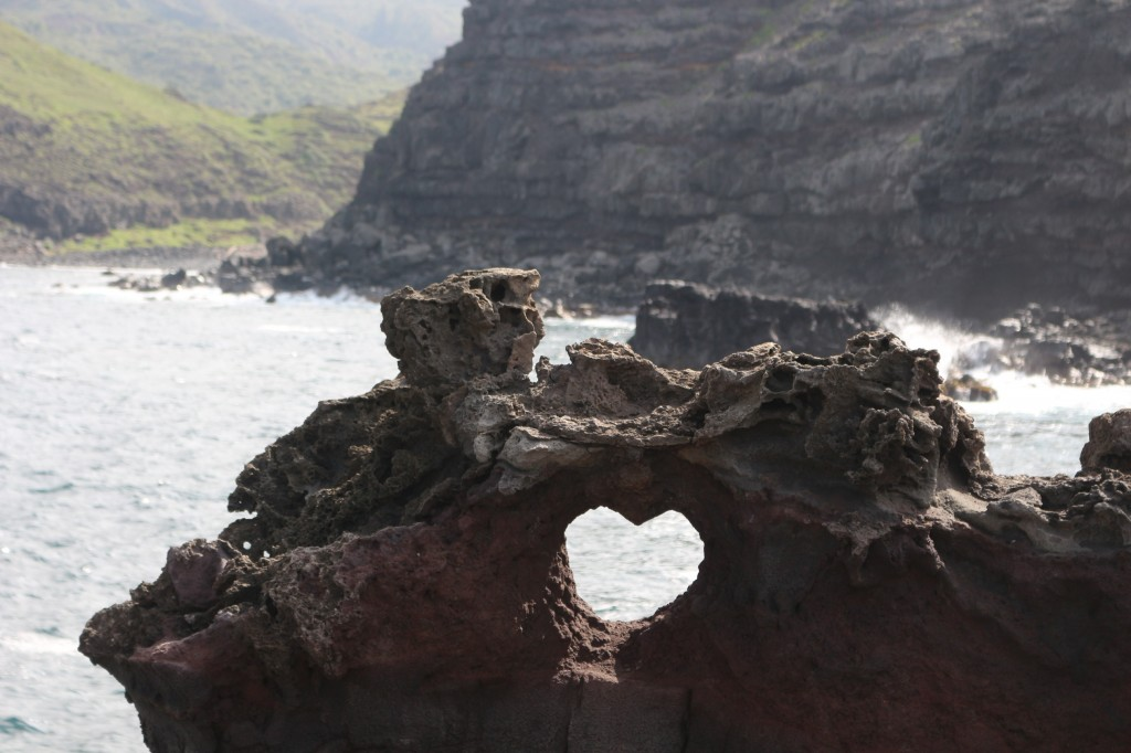 A heart shaped rock formation on the beach in Hawaii