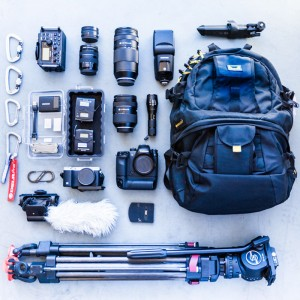 Inventory of camera gear laid out on floor