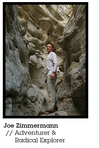 Joe Zimmermann, adventurer, idea man behind the Blackwater Drifters Expedition, and Mountainsmith Ambassador pictured hiking through a slot canyon in a white long sleeve shirt and khaki pants.