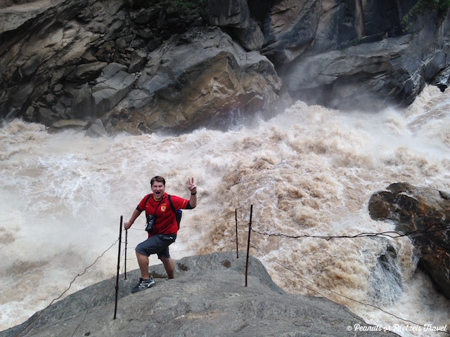 Mountainsmith Ambassador on the famous rock at Tiger Leaping Gorge