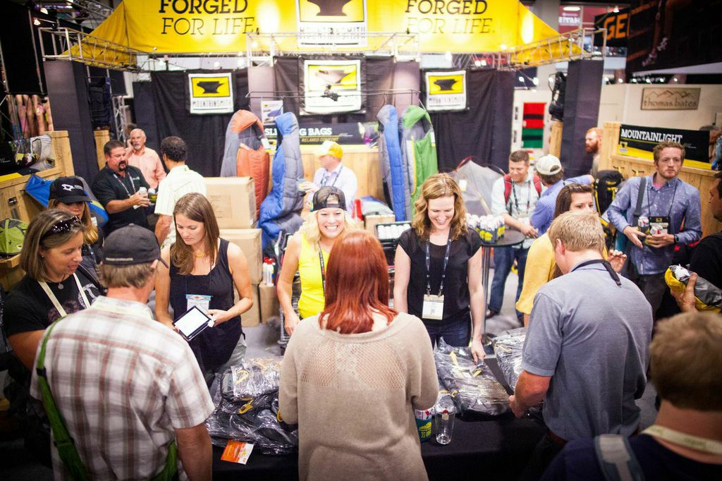 Employees of True Hero sell backpacks at the Mountainsmith during Outdoor Retailer summer 2014