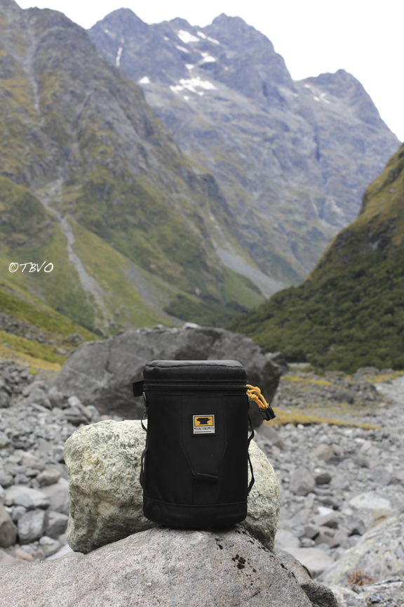 Mountainsmith lens case sitting on a rock in the middle of the mountains of New Zealand