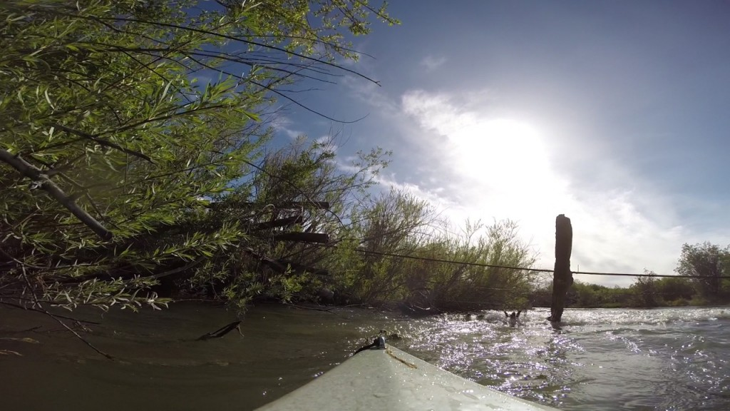 Blackwater Drifters kayak approaches barbed wire in the Red Rock River