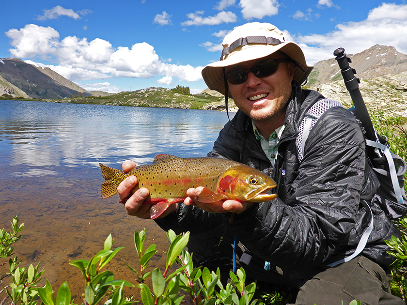Jonathan Hill holds a cutthroat trout in Colorado with this Mountainsmith Scream 25 backpack