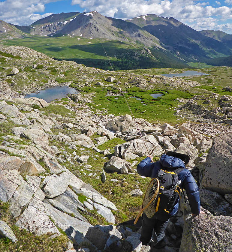 Fisherman Jonathan Hill hikes with the Mountainsmith Scream 25 backpack
