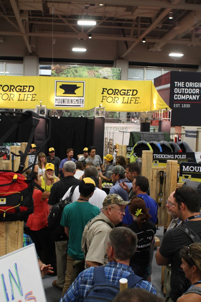 Outdoor Retailer attendees wait to buy a backpack at the Mountainsmith booth