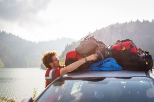 Ben Roif straps the Mountainsmith Travel Trunks ot the roof of his car
