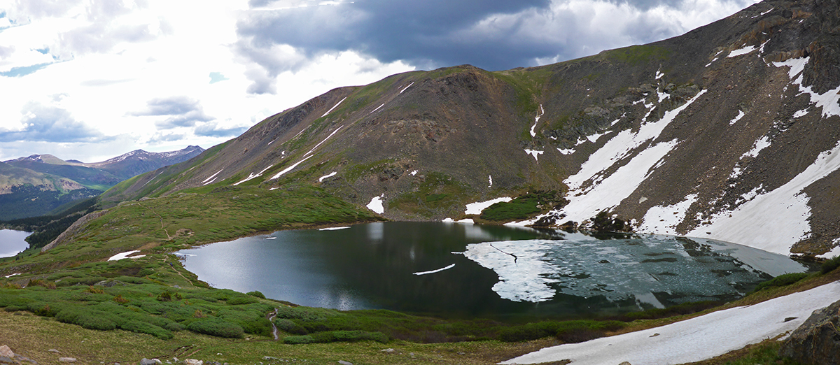 Ice still floating on the alpine lake in colorado