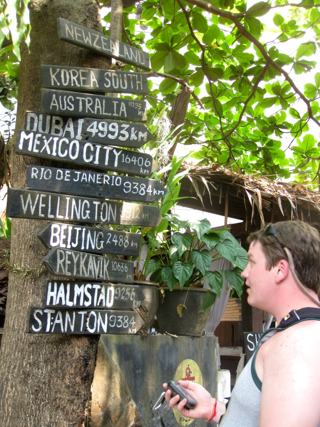 Josh Wilson reads a sign in Ko Phi Phi, Thailand