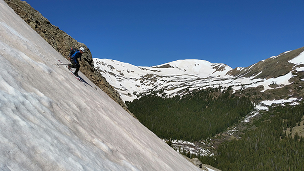 Darrin Young telemark skis down the snow field on Torrey's Peak