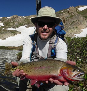 fisherman holding a cuttthroat trout