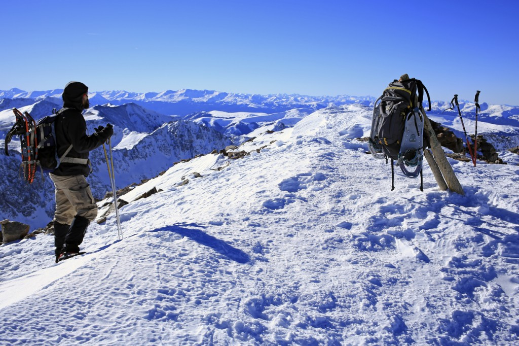 The Mountainsmith Ghost 50 backpack with snowshoes on top of Quandary peak in winter