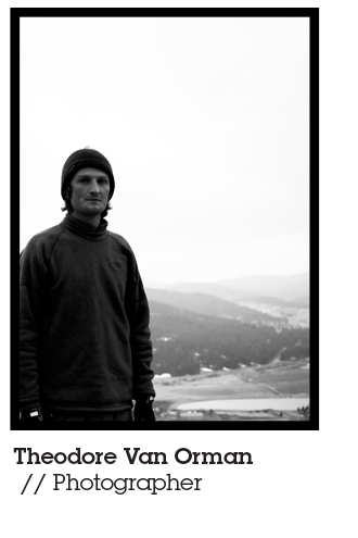 Theodore Van Orman Mountainsmith Brand Ambassador and photographer stands in front of a valley landscape
