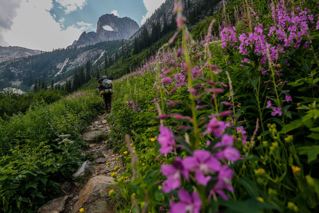 A hiker walks the Bugaboo Approach with the Mountainsmith Mystic 65 backpack