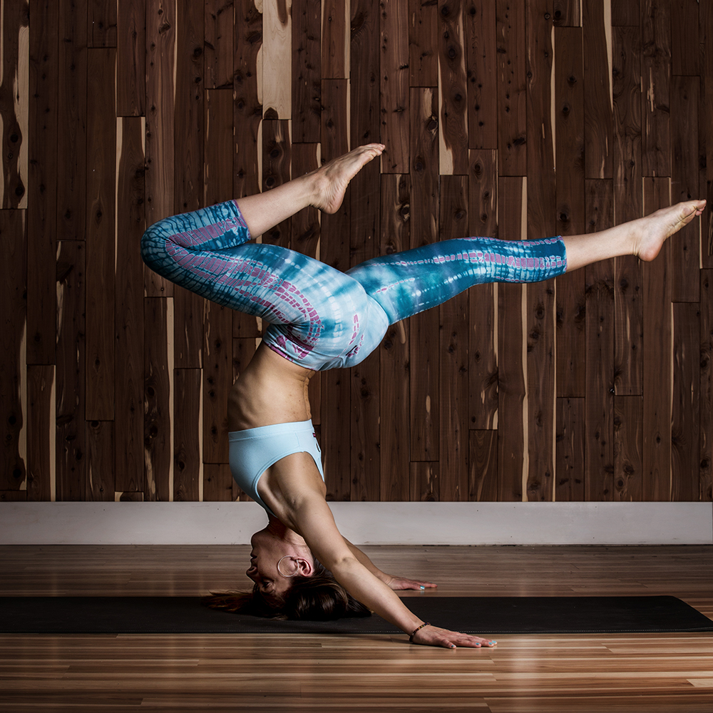 Chris Vultaggio photo of a woman doing a yoga headstand