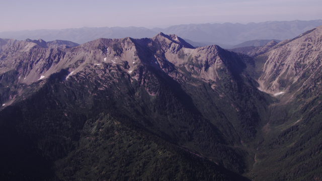 mountain view out a helicopter window with a RED epic camera