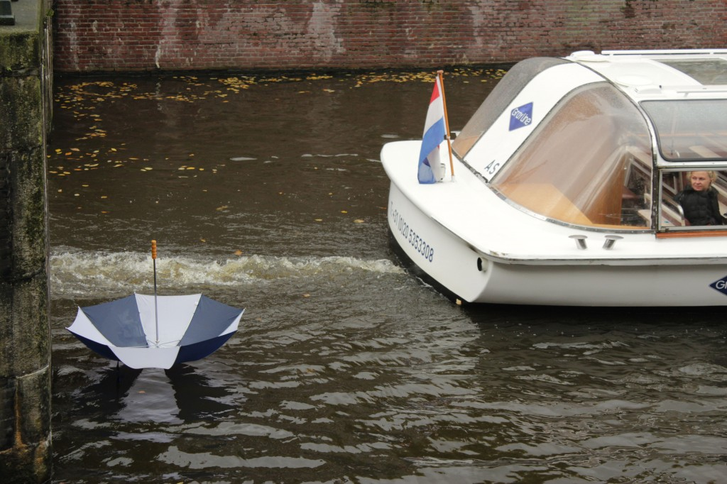 Man overboard amsterdam canal house boat umbrella