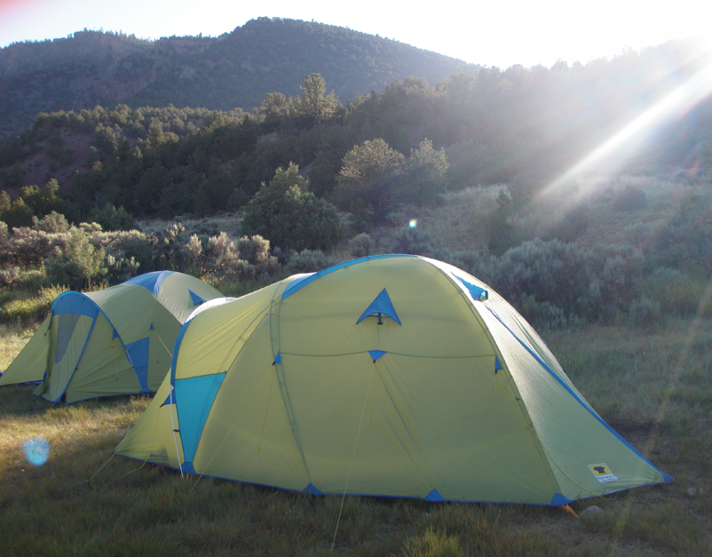 Two Mountainsmith Conifer 5+ tents set up on the side of the Colorado River