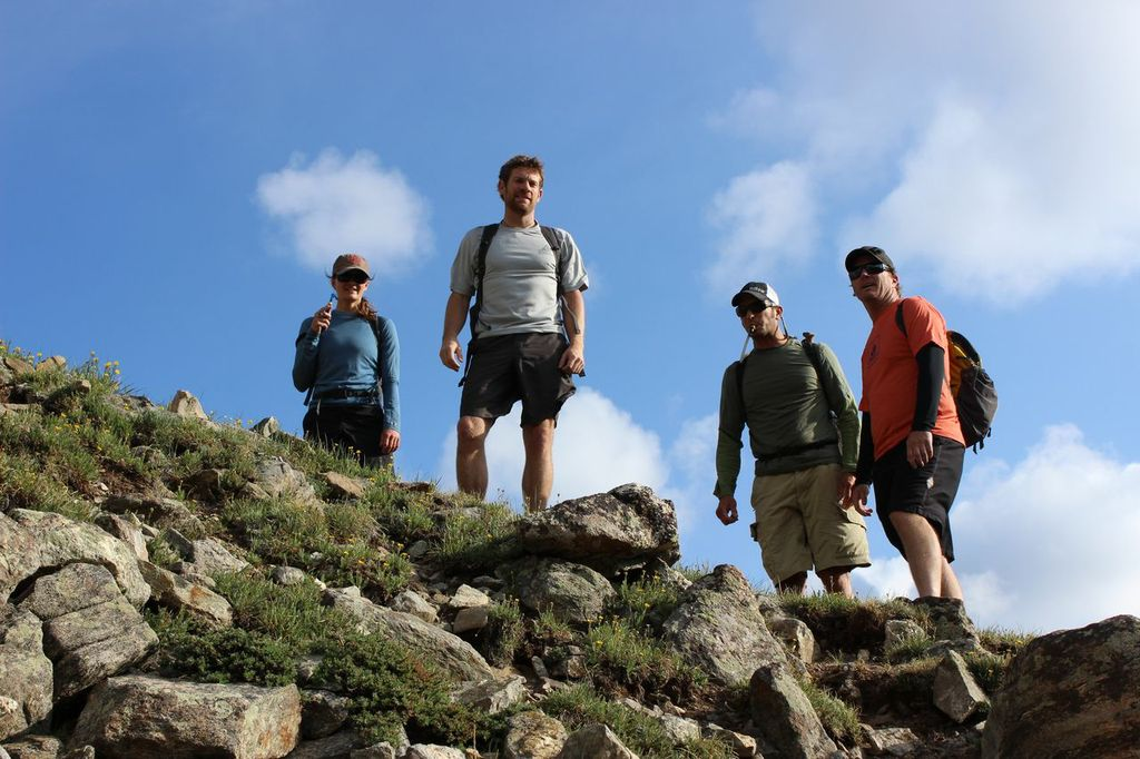 Jay Getzel, Vickie Hormuth, Keegan Young, and Erik Lambert stand at the bottom of Kelso Ridge