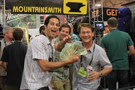 Jay Getzel gives cash to the AAC American Alpine Club on behalf of Mountainsmith at the Outdoor Retailer Summer Market show in July of 2012
