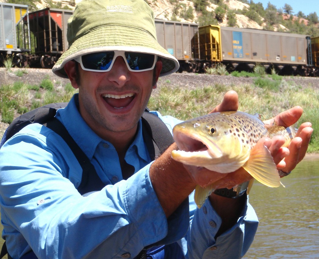 Mountainsmith's President Jay Getzel holding a Brown Trout on the Colorado River