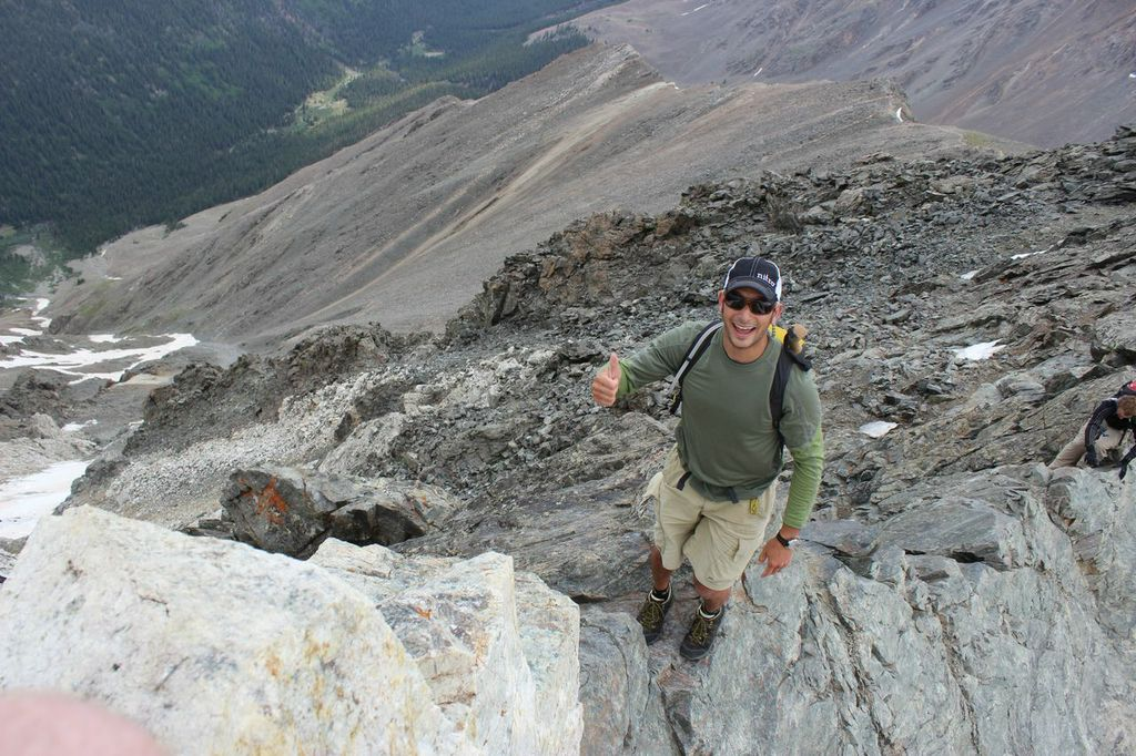 President of Mountainsmith Jay Getzel stands on a knife-edge route on Kelso Ridge