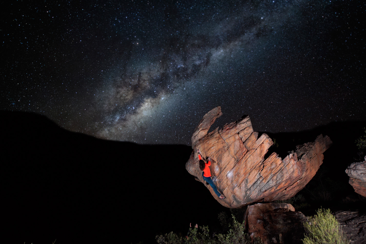 climber in front of the milky way in the night sky