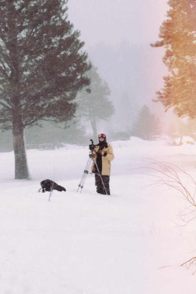 AJ Marino shoots skiers with his video camera on a tripod in meyers. california