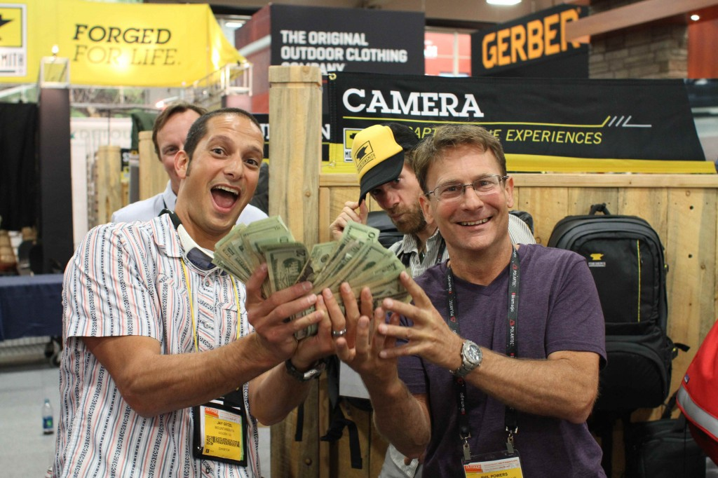 Mountainsmith president Jay Getzel hands over $5,000 to Phil Powers of the AAC