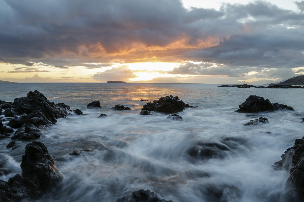 a long exposure sunset view of molokini island from maui in hawaii